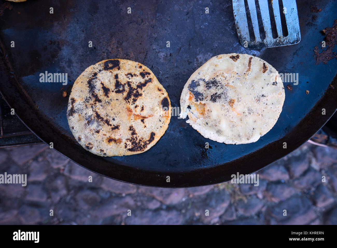 Mexican cheese flat bread called gorditas made by street vendors Stock Photo