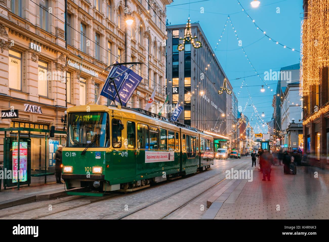 Helsinki, Finland - December 8, 2016: Tram Departs From A Stop On Aleksanterinkatu Street. Night View Of Aleksanterinkatu - Stock Image