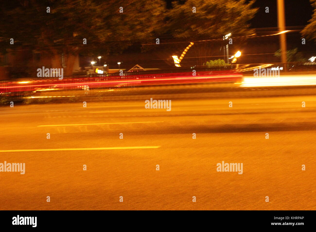 A car zooming down the street - Stock Image