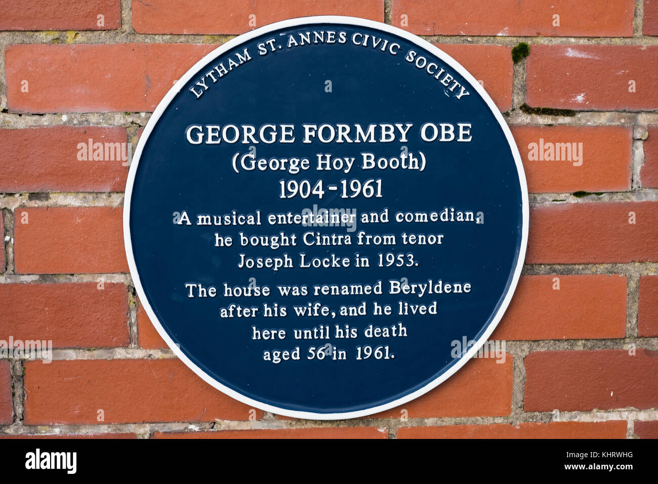 A Blue plaque commemorating the past home of George Formby OBE, at Lytham St Annes, Lancashire. - Stock Image
