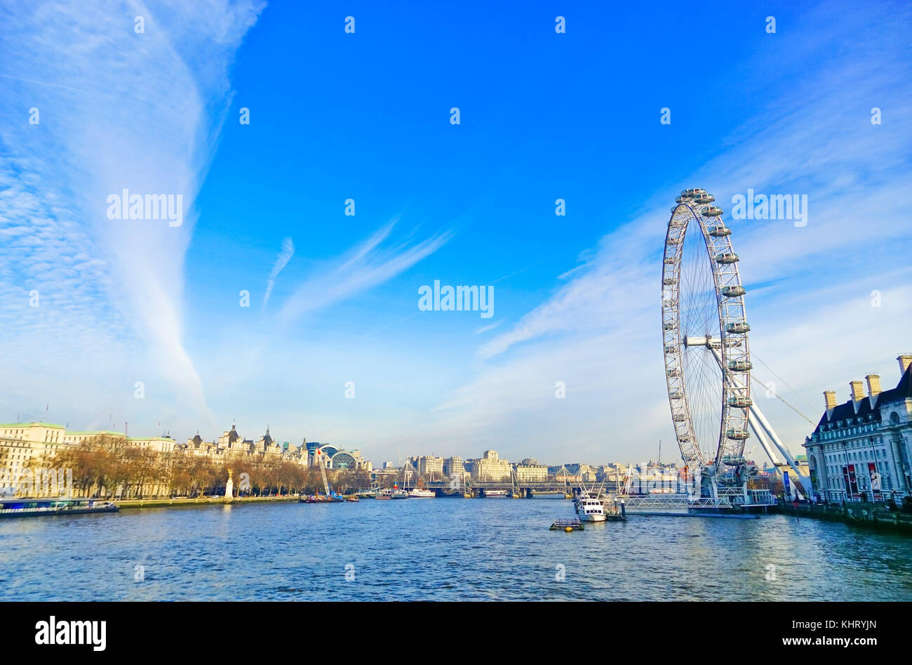 View of the River Thames with London Eye in a sunny day - Stock Image