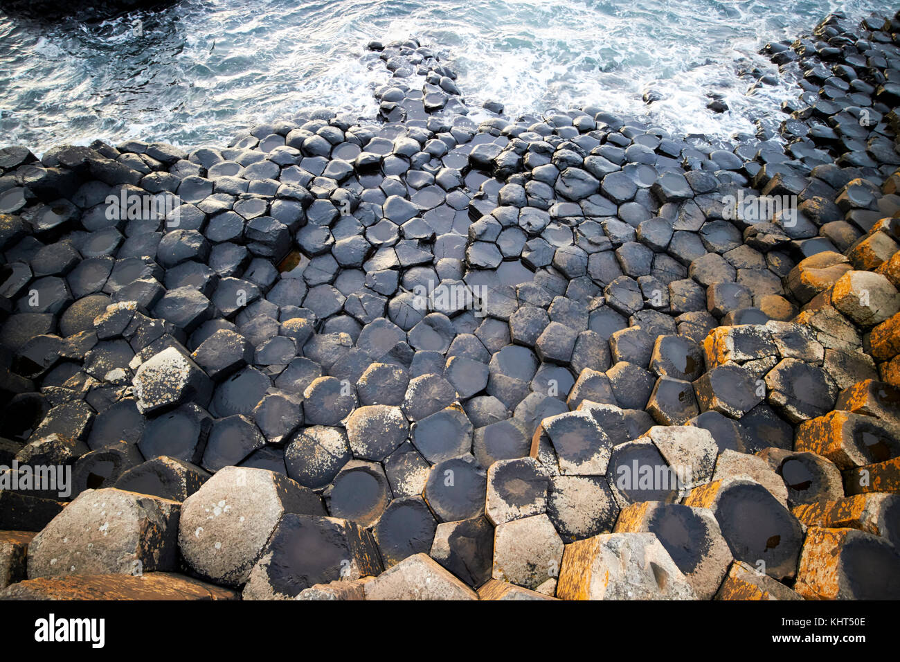 rocks below the waterline at Giants Causeway county antrim northern ireland uk - Stock Image