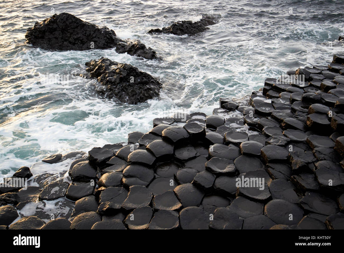 sea and rocks at the Giants Causeway county antrim northern ireland uk - Stock Image