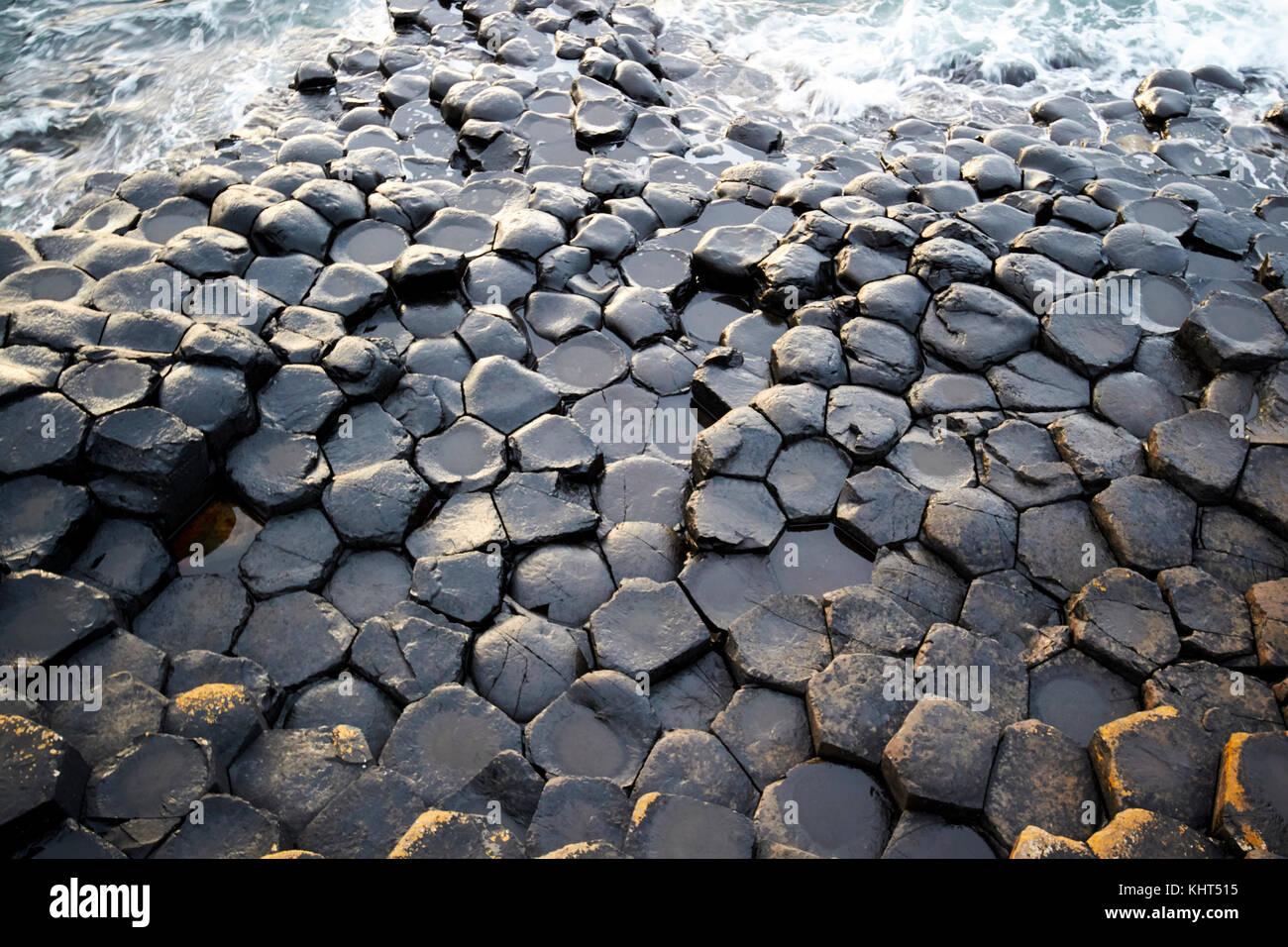 black shaped rocks near the Giants Causeway county antrim northern ireland uk - Stock Image
