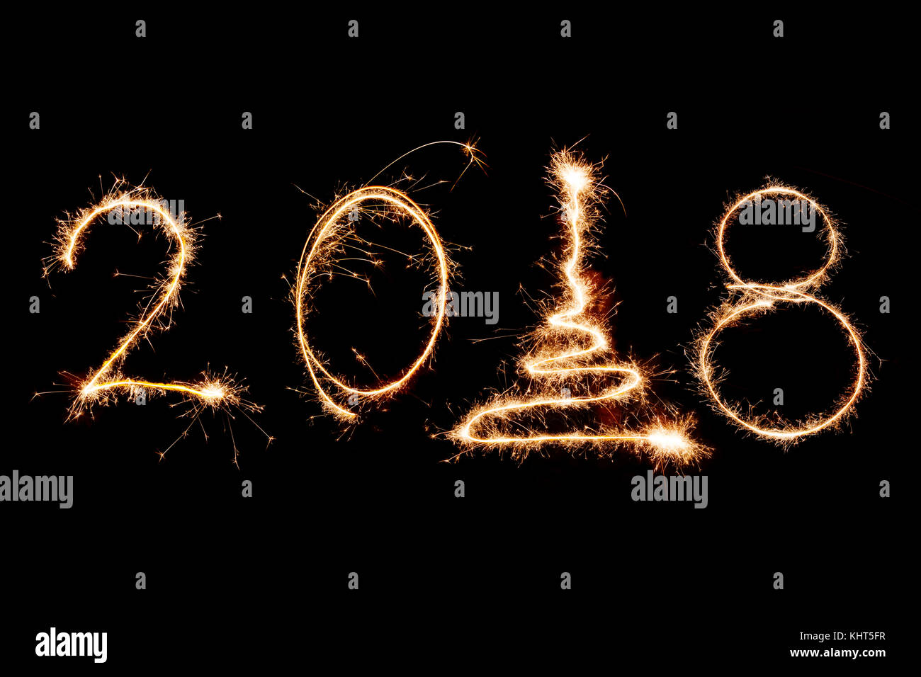 2018 written with Sparkle firework on black background, happy new year 2018 concept. - Stock Image