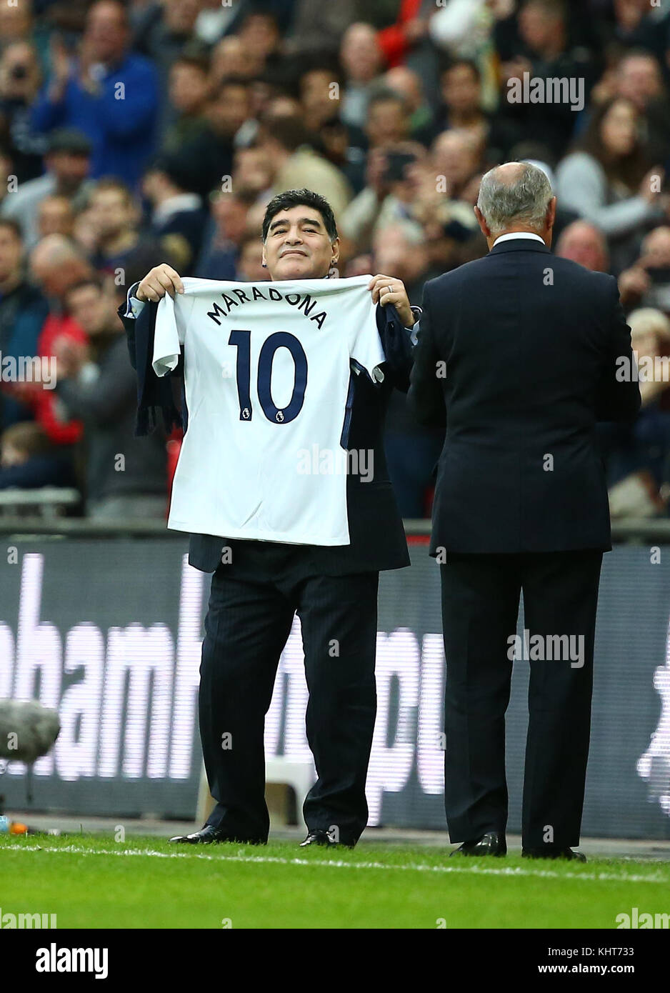 Diego Maradona waves a personalised Spurs shirt  at the Premier League match between Tottenham Hotspur and Liverpool - Stock Image