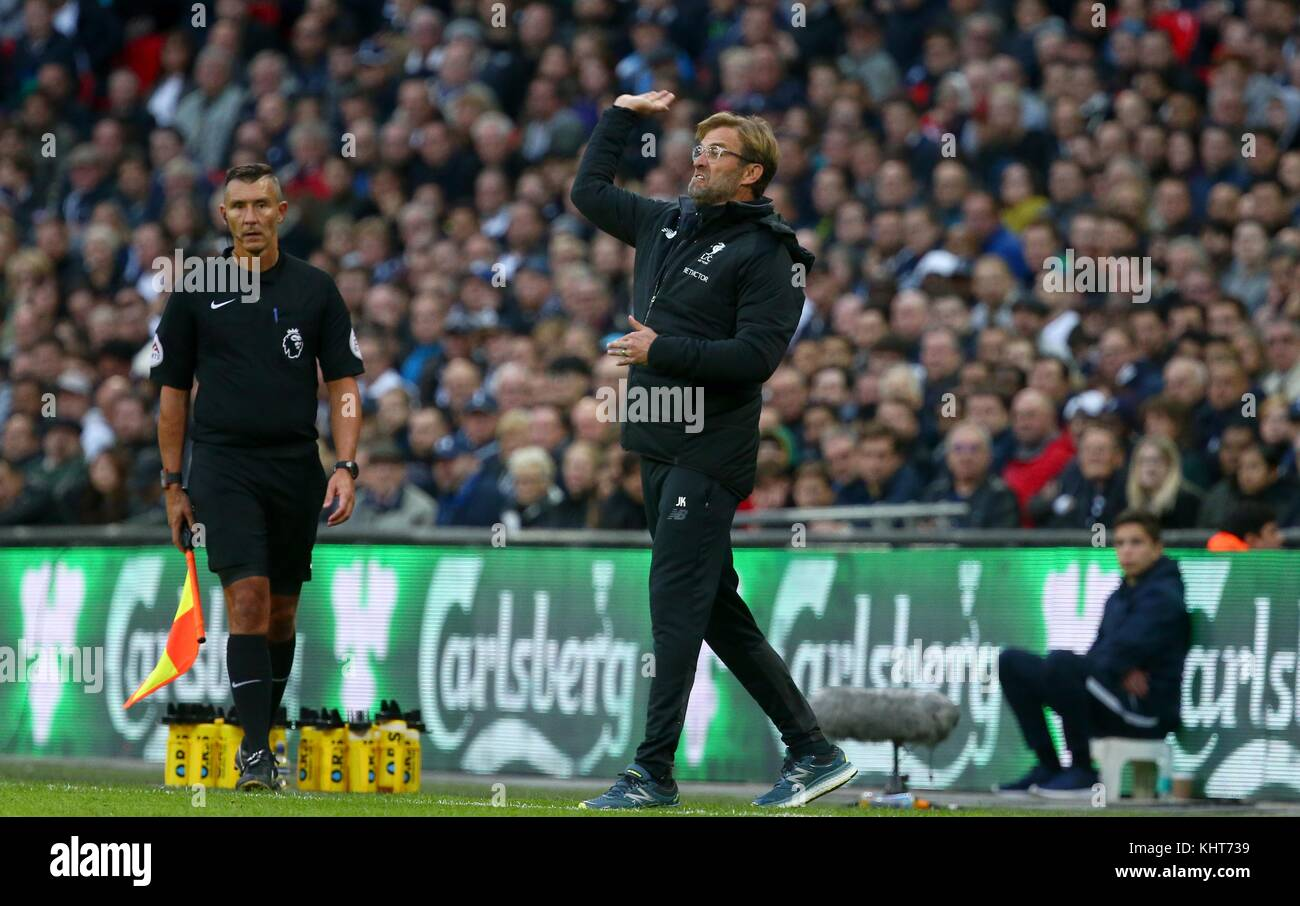 Liverpool manager Jurgen Klopp gestures to his players during the Premier League match between Tottenham Hotspur - Stock Image