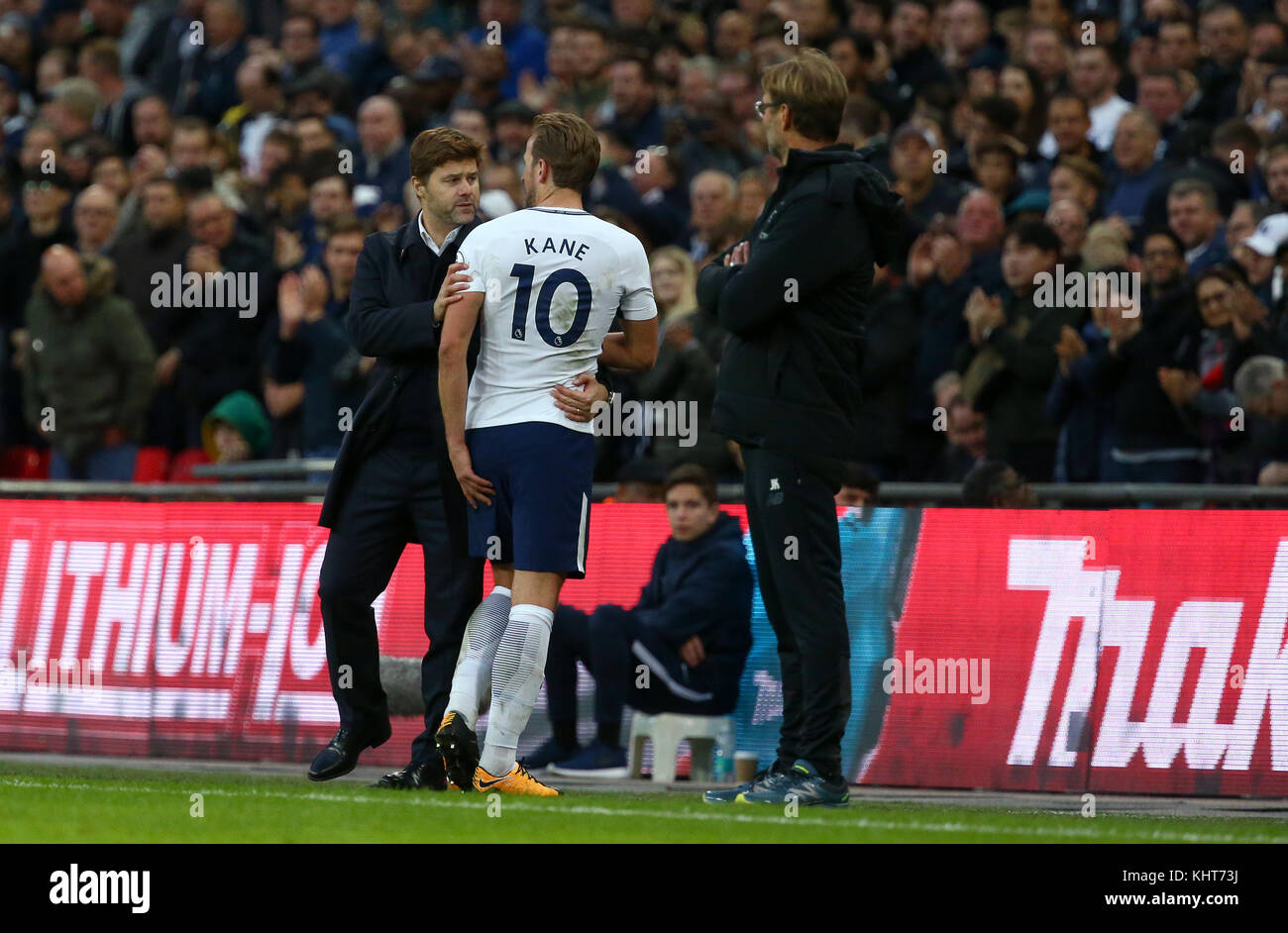 Tottenham manager Mauricio Pochettino congratulates Harry Kane as he is substituted during the Premier League match - Stock Image