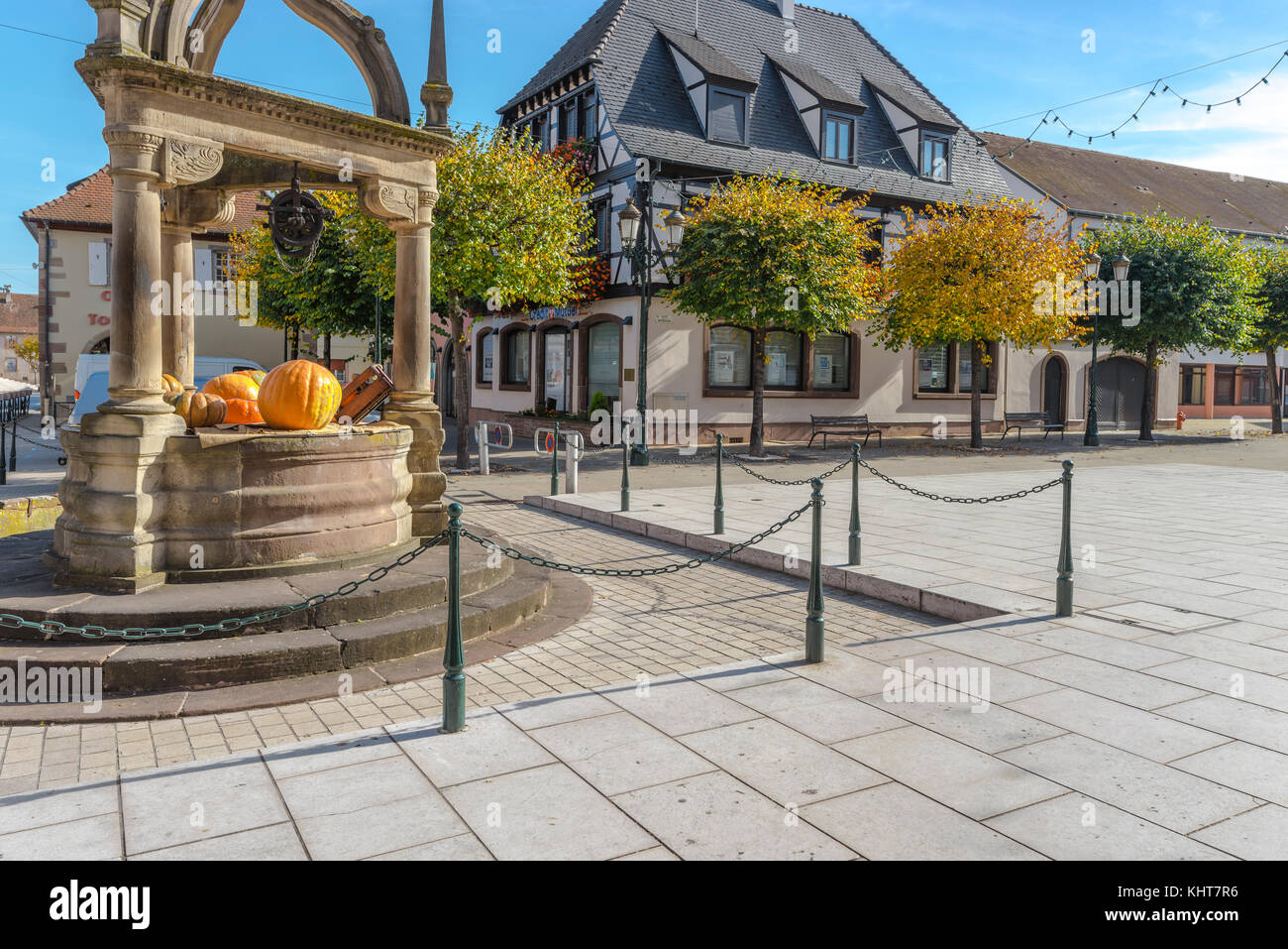 medieval well decorated with pumpkin, picturesque village Rosheim, Alsace, France - Stock Image