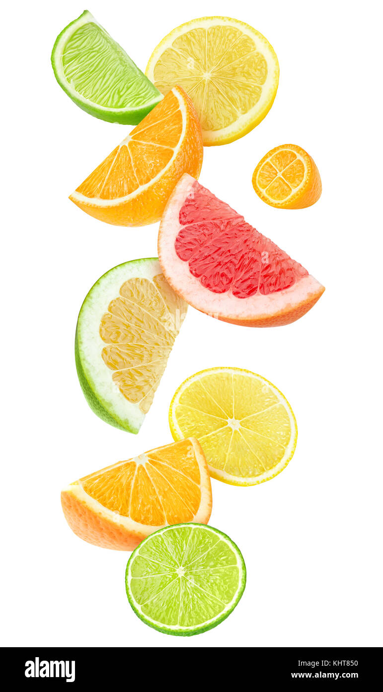 Isolated citrus fruits pieces in the air. Sliced orange, lemon, lime, grapefruit and kumquat falling isolated on Stock Photo