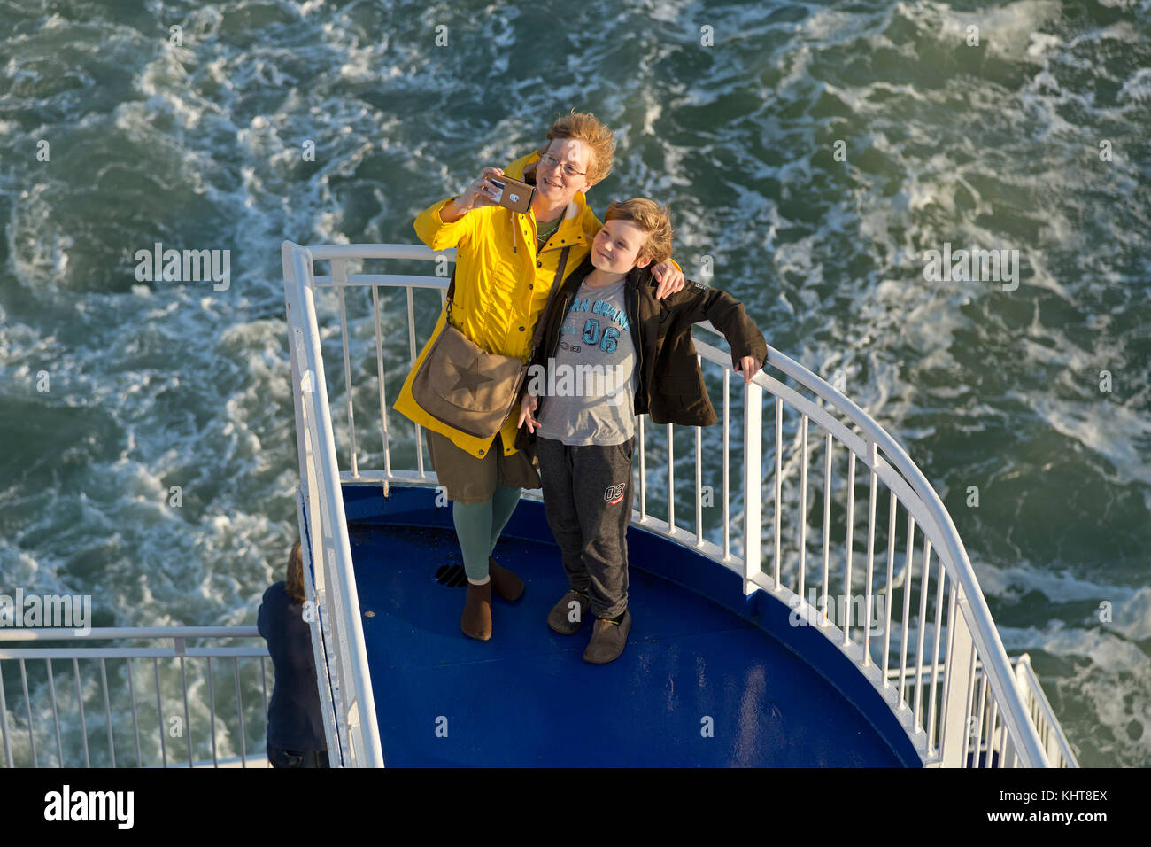 mother and son on the ferry from Ijmuiden, Netherlands to Newcastle, England - Stock Image