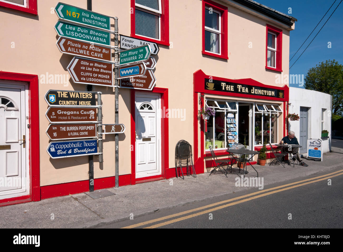 Road signs and tea house in Ballyvaughan, County Clare, Ireland - Stock Image