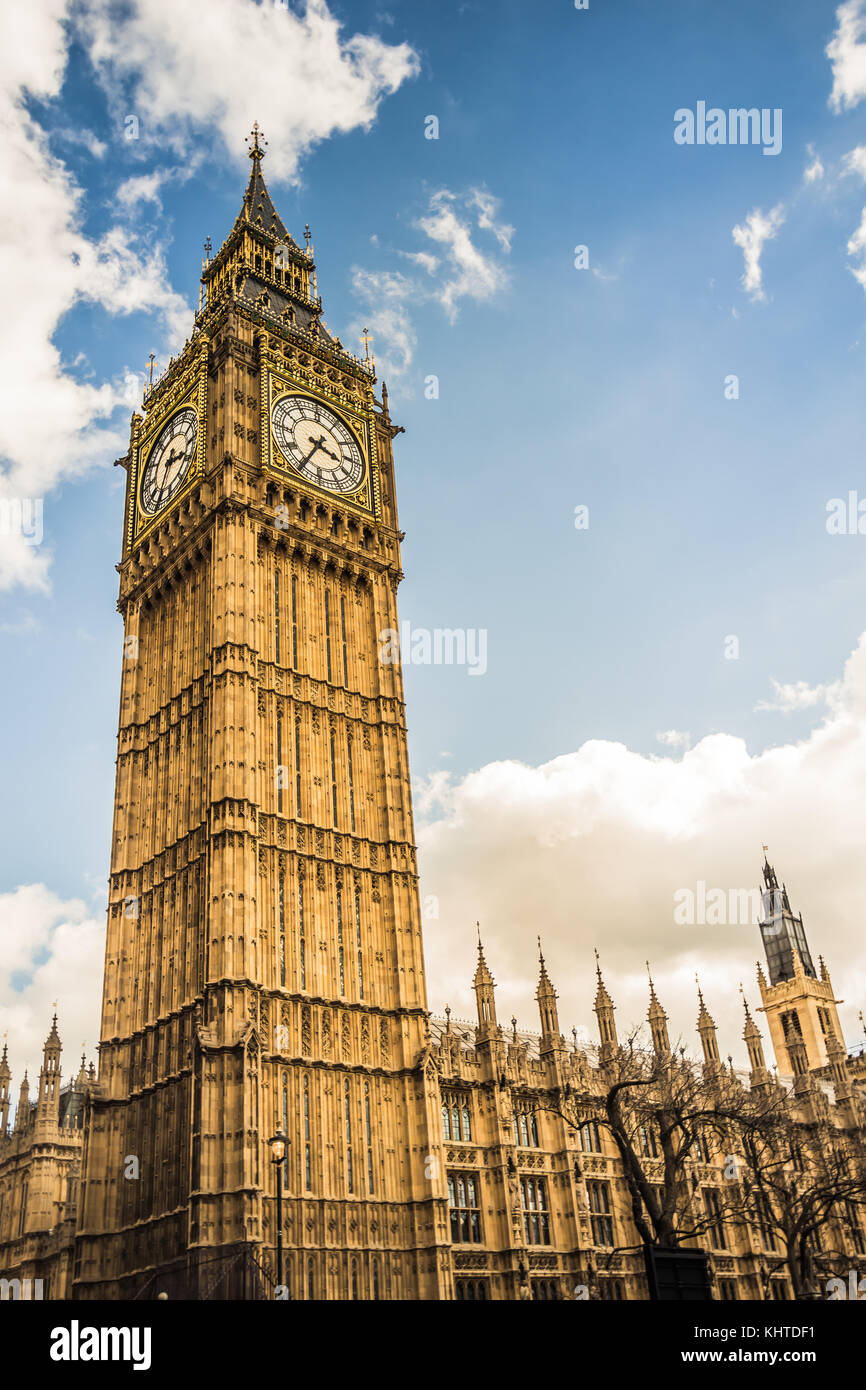 Big Ben tower in central London, wide angle shot from below looking up into the sky. - Stock Image