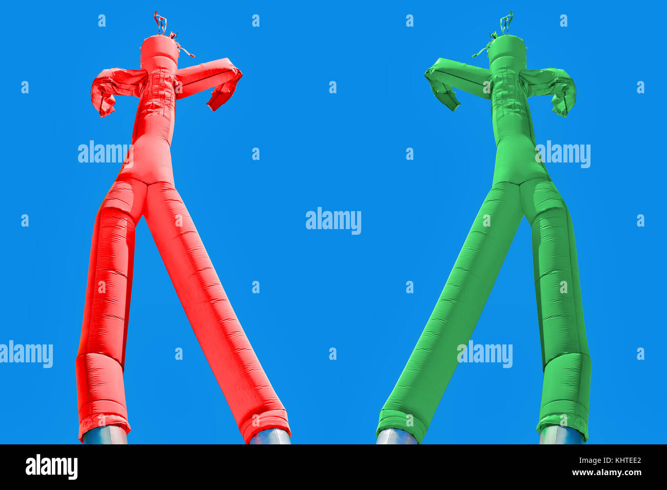 Two inflatable man. Green and Red. Choices concept. Two different directions. Decision concept, red or green, left - Stock Image