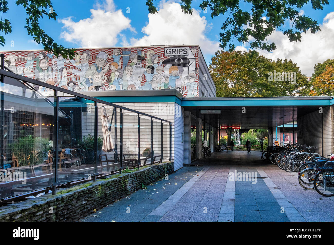 Berlin Hansaplatz. Grips Theater.Theatre for children & youth.Building exterior with mosaic of caricatures by - Stock Image