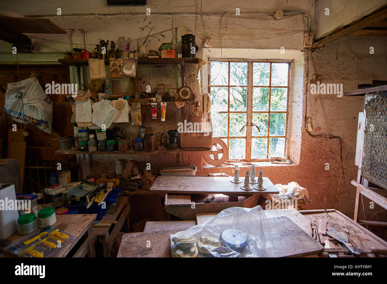 Cluttered work bench and shelving in pottery studio, Longsleddale, Kentmere, Lake District - Stock Image