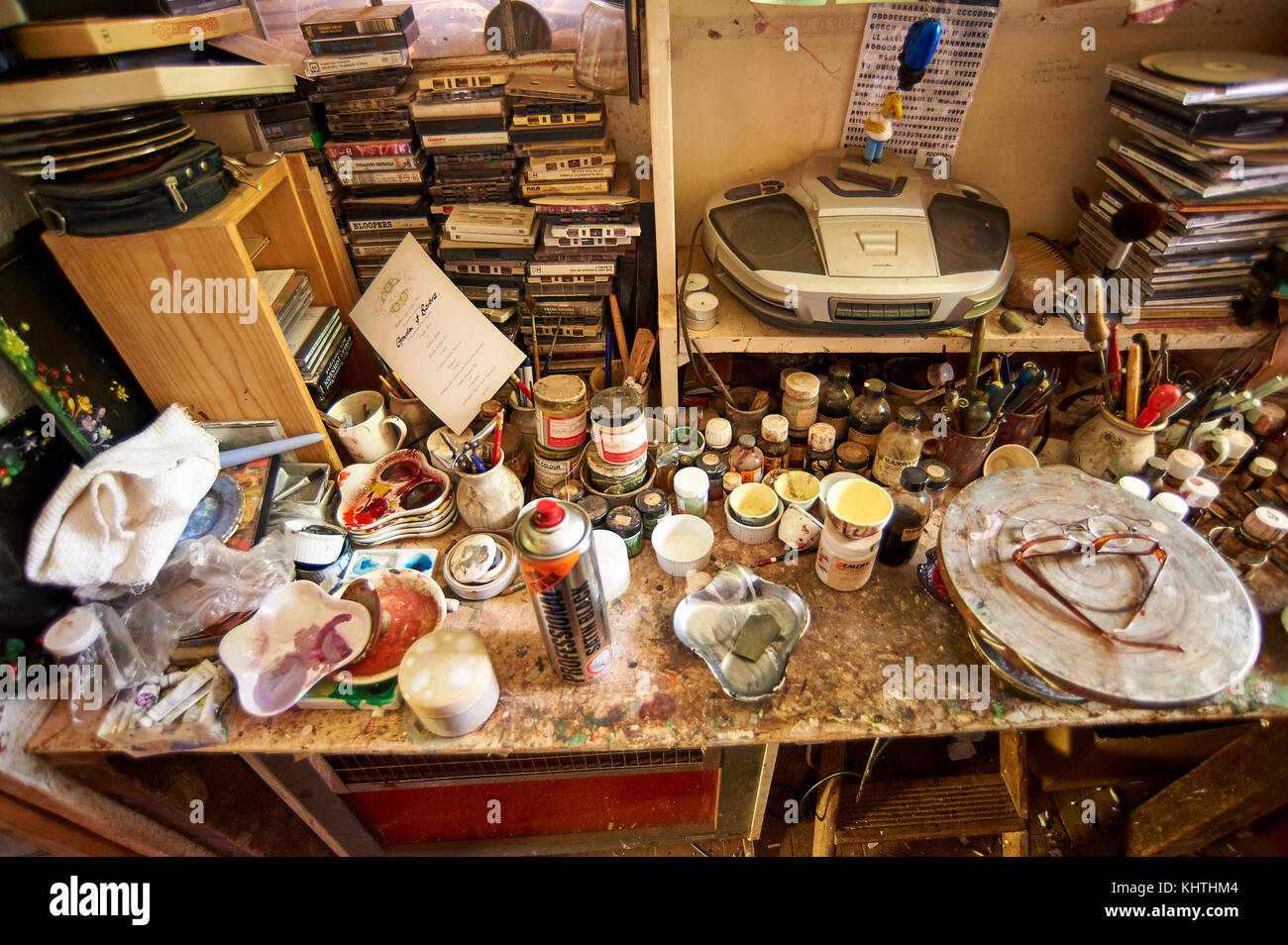 Work bench cluttered with paints and potters wheel in pottery studio, Longsleddale, Kentmere, Lake District - Stock Image