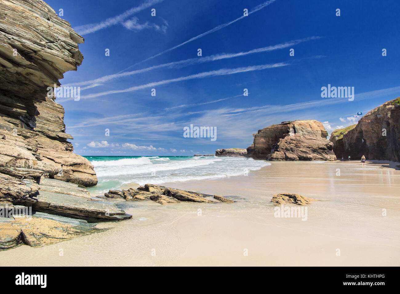View of the ocean between rocks of Praia de Augas Santas. A fragment of the beach of cathedrals in summer day in - Stock Image