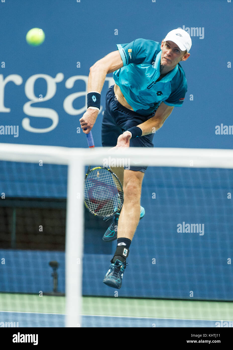 South African tennis player KEVIN ANDERSON (RSA) hitting a service shot  at US Open 2017 Tennis Championship, New - Stock Image