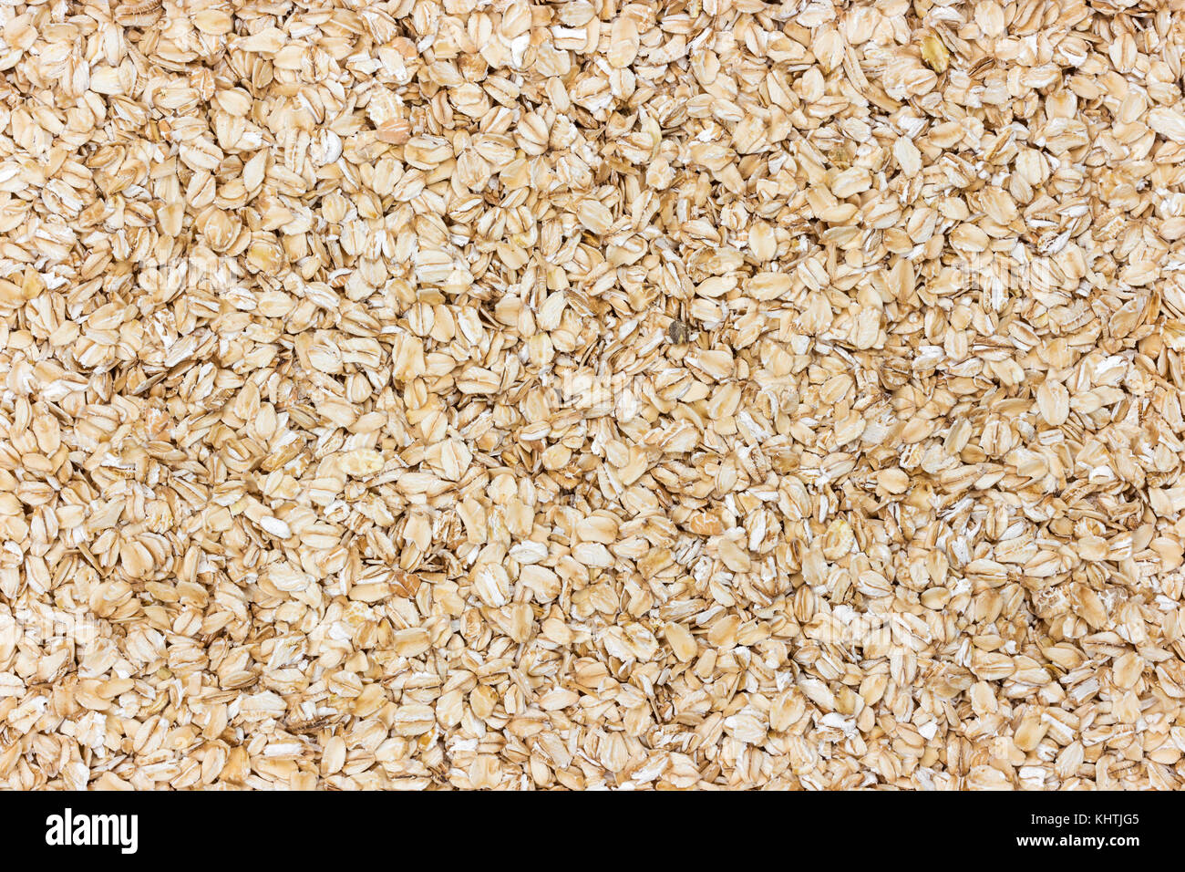Oatmeal background. Oat flakes texture - Stock Image