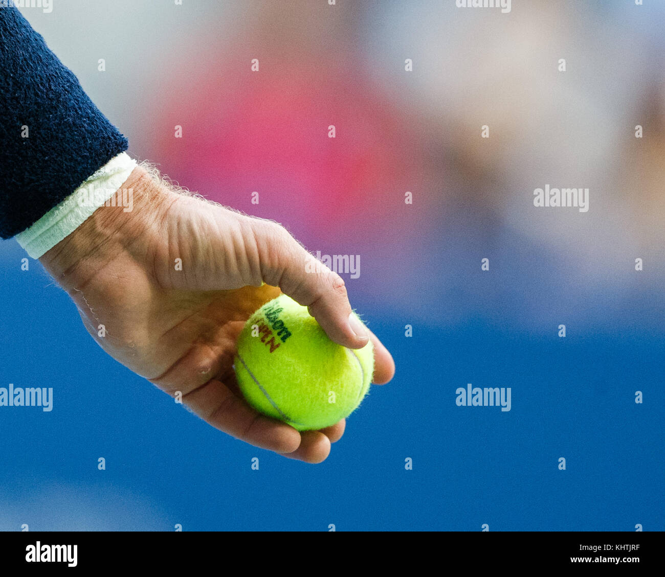 South African tennis player Kevin Anderson holding ball on court during men's singles final match in US Open - Stock Image