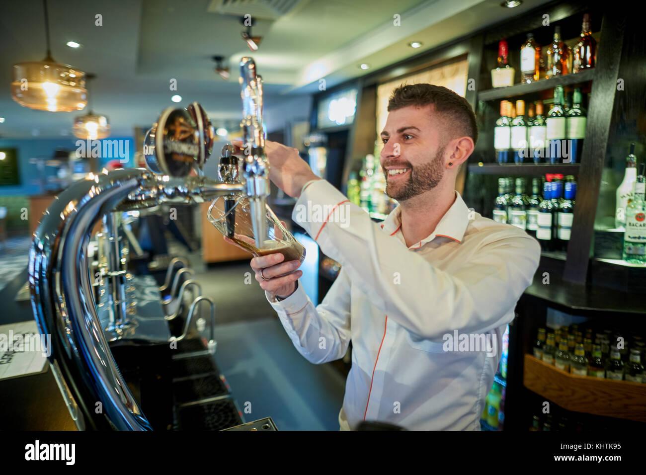 MARSTON'S, THE OLD DUKE pub barman pulling at pint - Stock Image