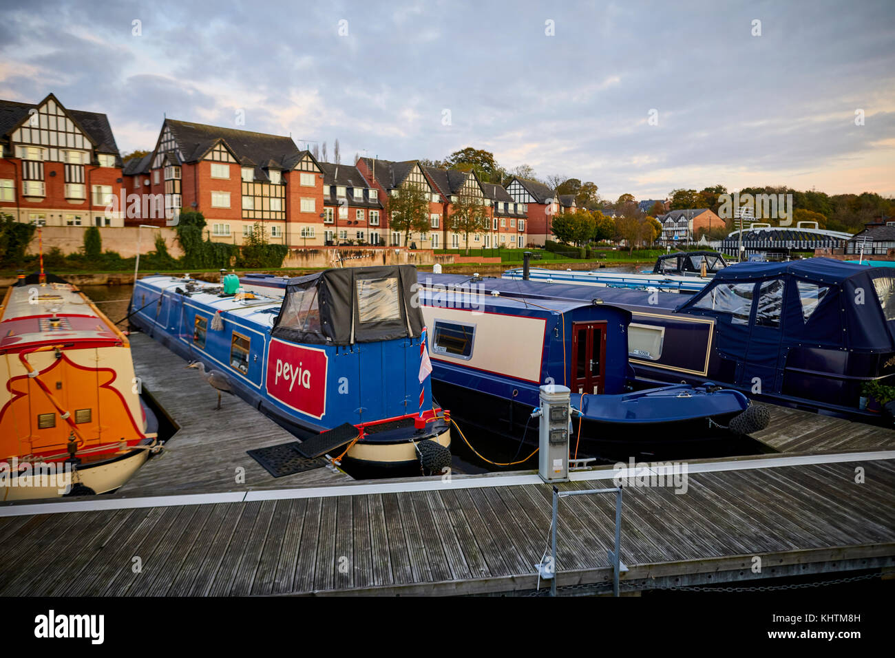 Northwich Marina on the River Weaver in the town centre, with lots of canal boats anchored down. Autumn in Northwich, - Stock Image
