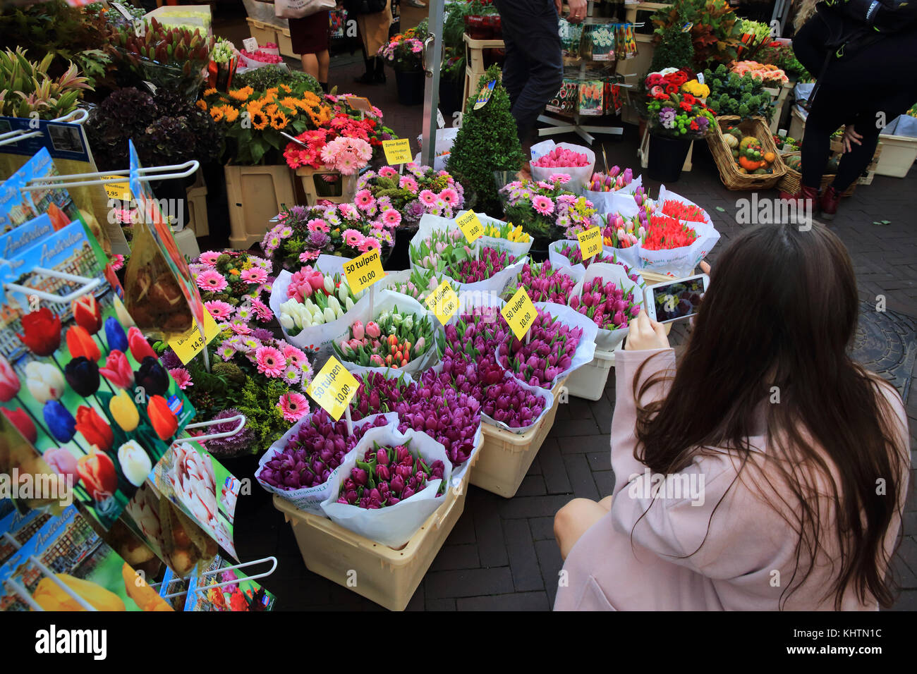 The world famous floating flower market on the Singel canal, in Amsterdam in the Netherlands Stock Photo