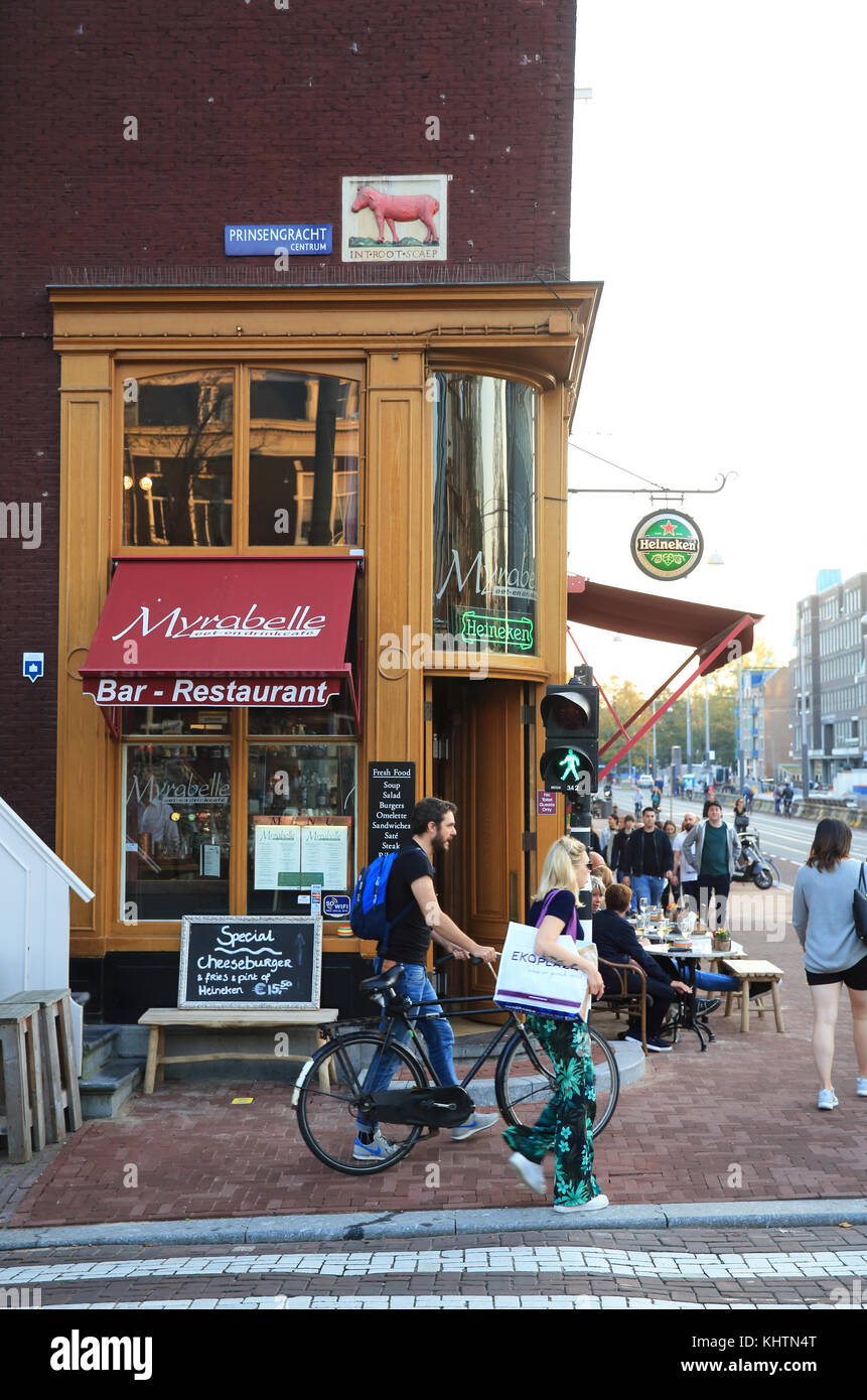 Bar restaurant on the Prinsengracht canal, in Autumn, in Amsterdam, in the Netherlands - Stock Image