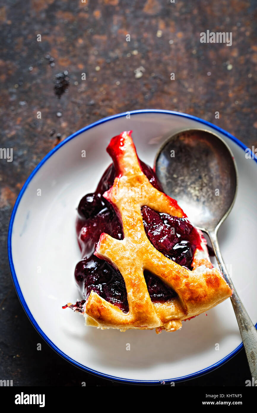 Lattice autumn fruit pie, with blackcurrant, blackberry, cherry compote in puff pastry pie - Stock Image