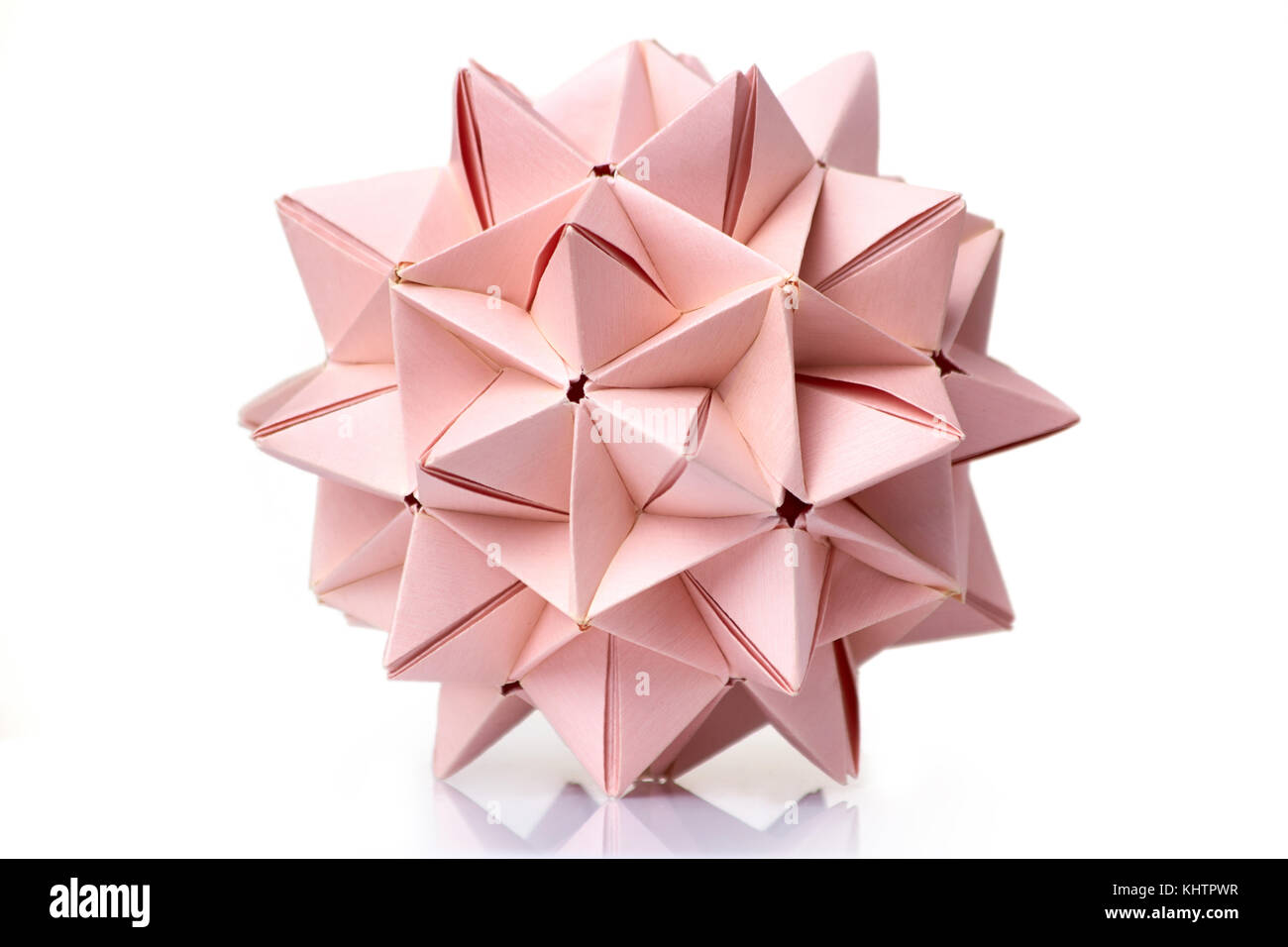 Blue origami transforming spiky ball. bright isolated background.   956x1300