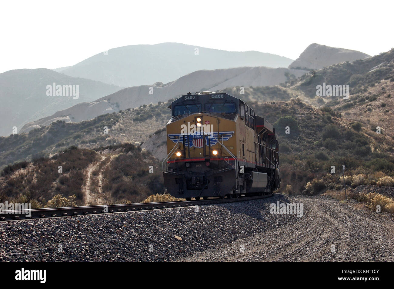 a union pacific locomotive climbing uphill at cajon pass in california,  usa  - stock