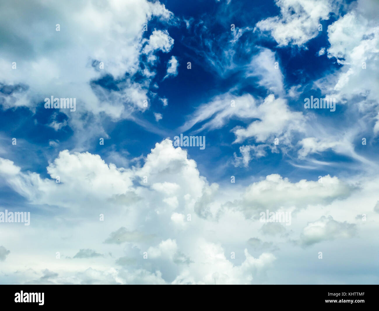 heap clound blue sky background at midday in spring - Stock Image