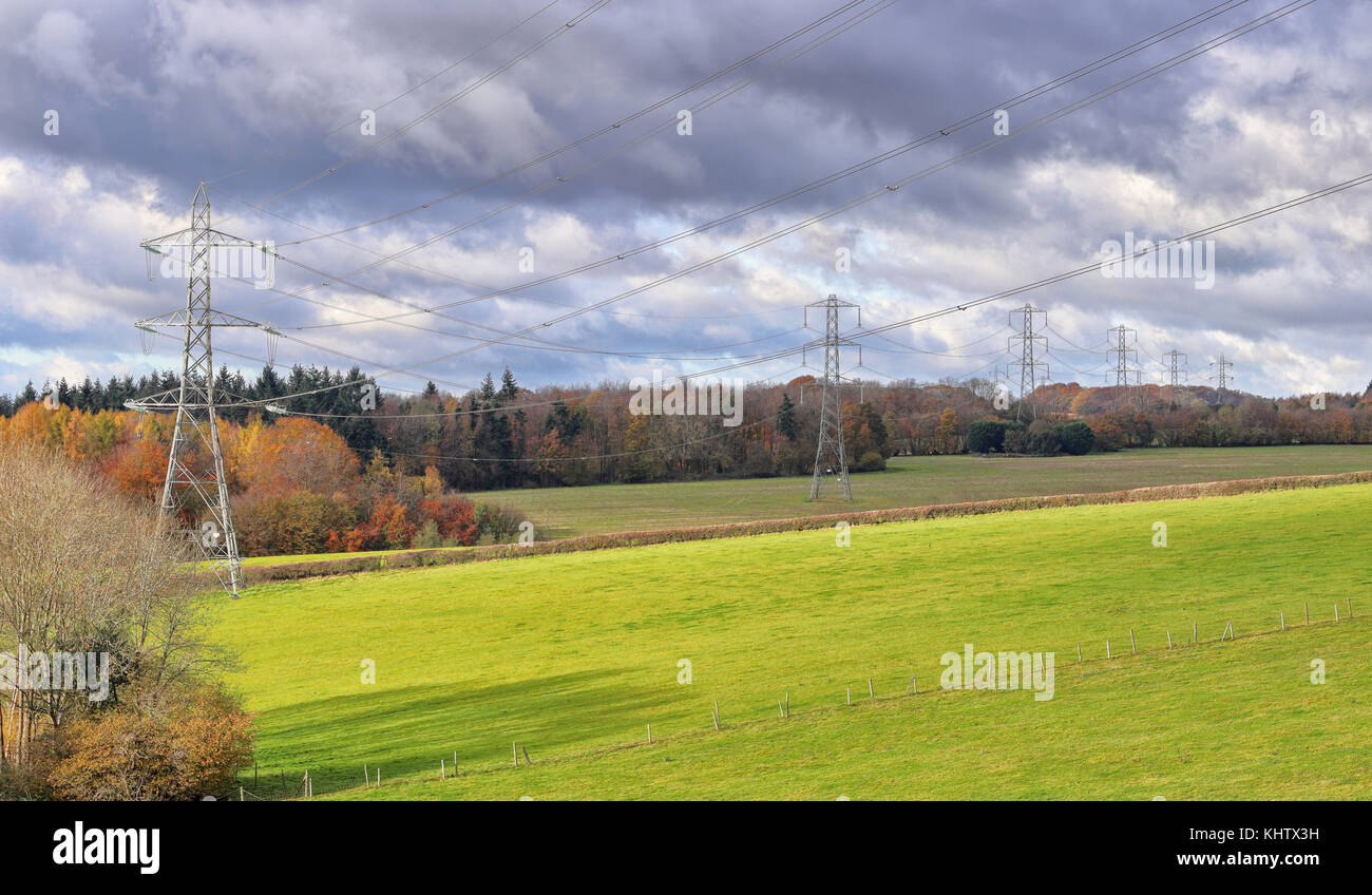Row of Electricity Pylons in the Chiltern Hills in rural Buckinghamshire in England - Stock Image
