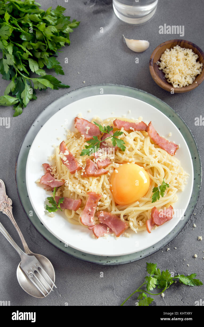 Spaghetti carbonara pasta with egg sauce, bacon and grated parmesan cheese  - homemade healthy italian pasta on - Stock Image