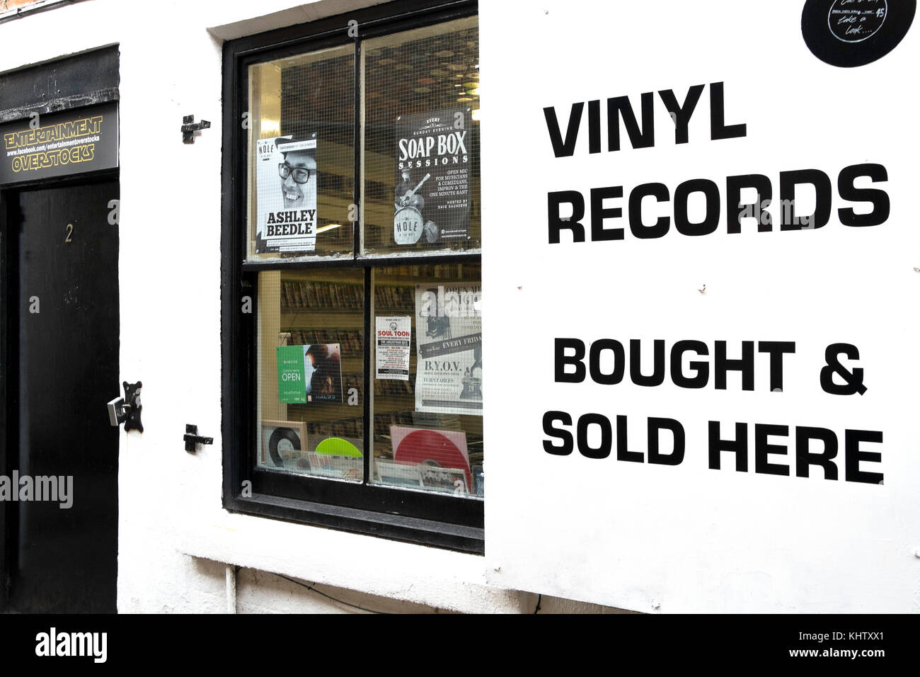 A small music shop in Northern England with a prominent sign Vinyl Records Bought and Sold Here - Stock Image