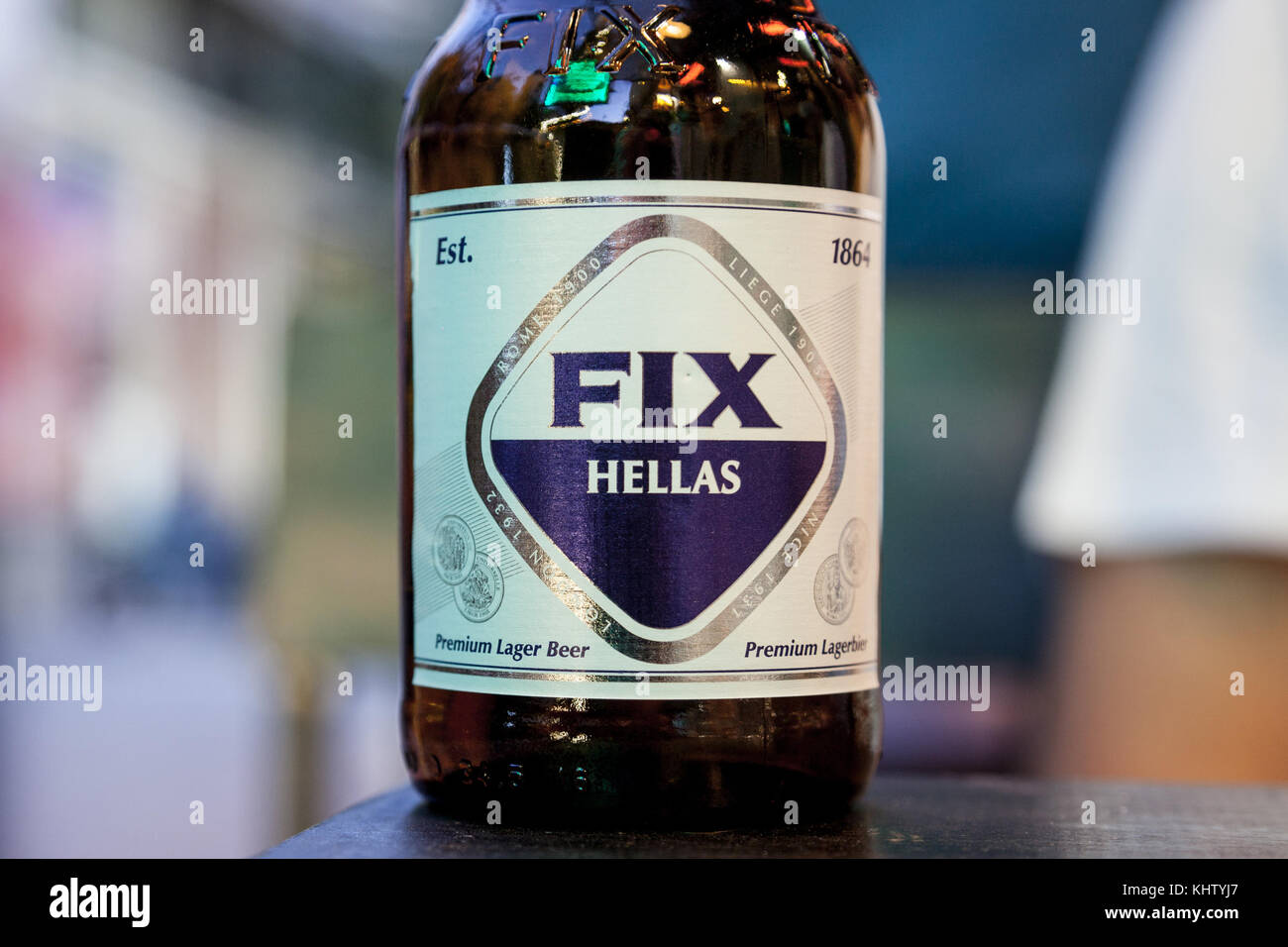 ATHENS, GREECE - NOVEMBER 3, 2017: Close up on a bottle of Fix Beer in a traditionnal glass bottle at night. Fix, - Stock Image