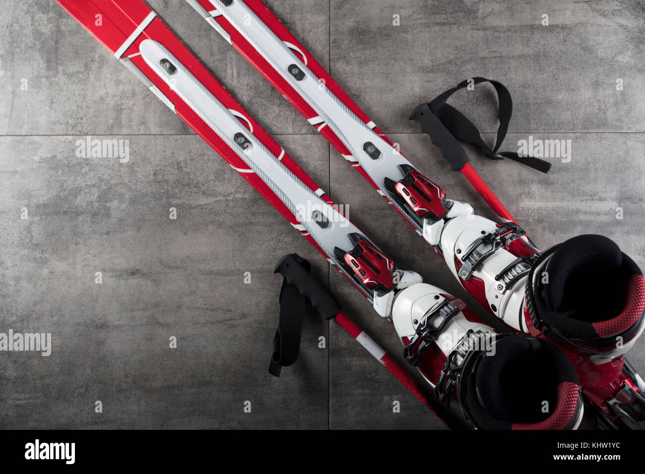 Winter sport theme. Ski equipment on gray tiles. Place for typography. Top view. - Stock Image