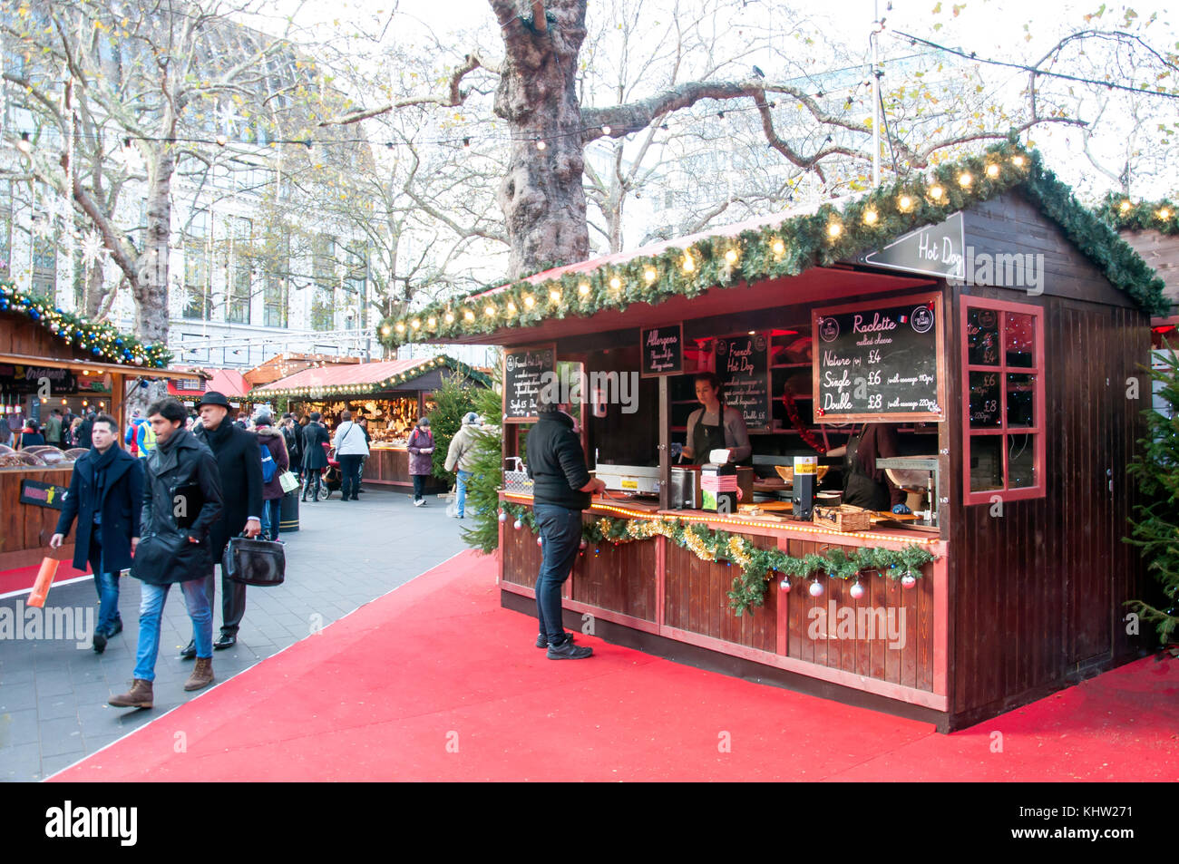 French raclette stall at Christmas in Leicester Square festival, Leicester Square, West End, City of Westminster, - Stock Image