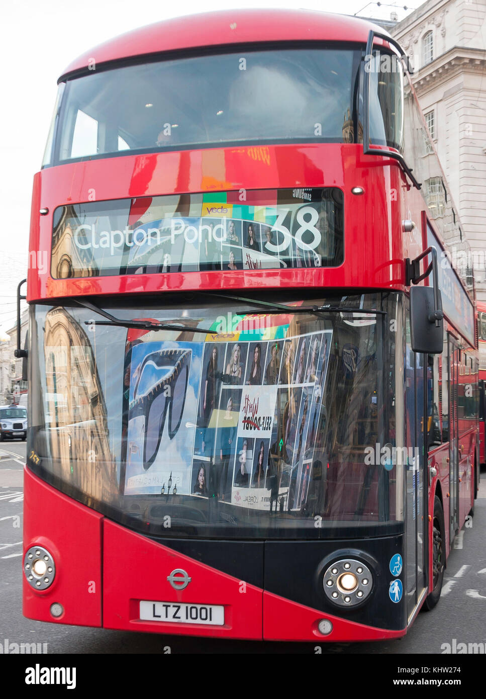 Clapton bus with neon sign reflections, Piccadilly Circus, Piccadilly, West End, City of Westminster, Greater London, - Stock Image