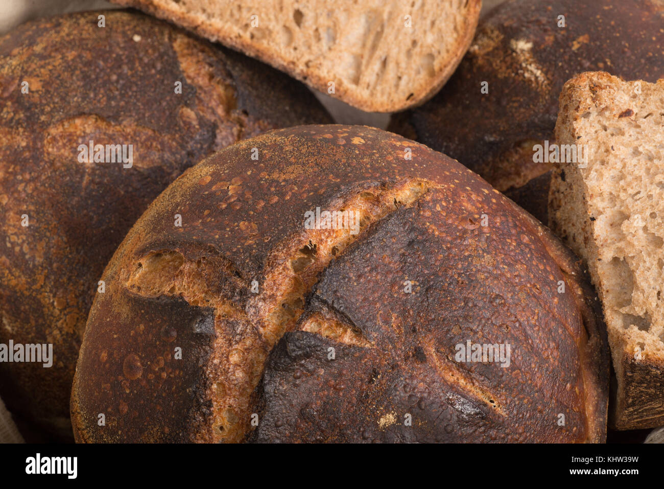 Fresh Baked Loafs Of Round Artisan Sour Dough Whole Wheat Bread In A Basket