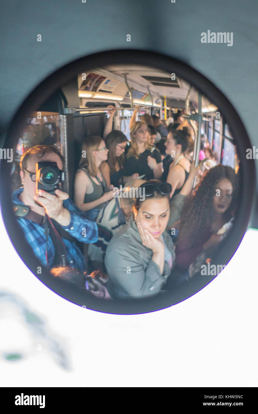 Standing Room Only Traveling On A Crowded Bus Stock Photo