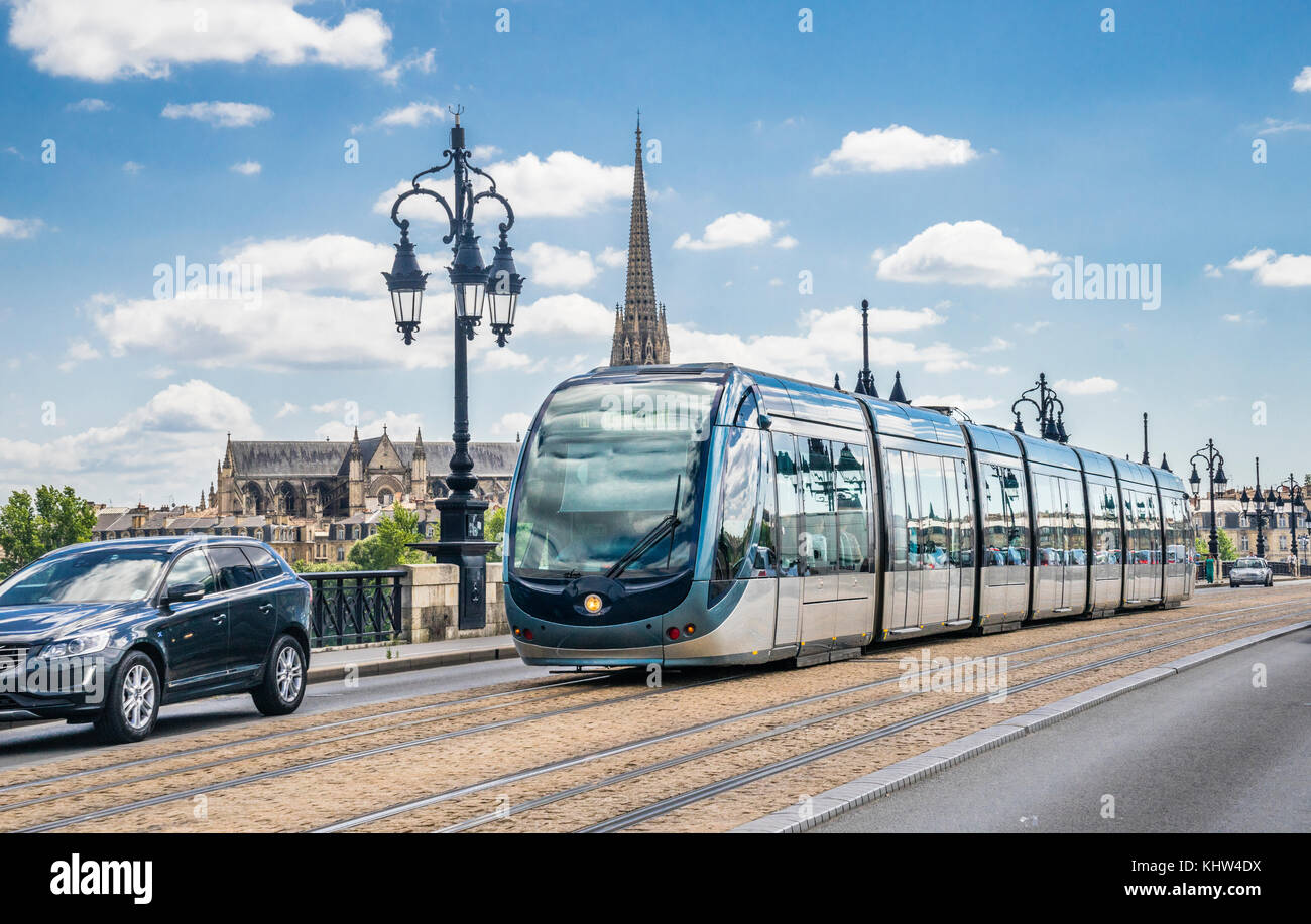 France, Gironde department, Bordeaux, a modern tram of the Bordeaux tramway network is crossing the Pont-de-Pierre - Stock Image