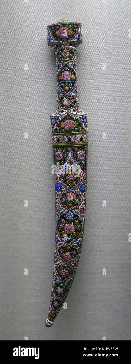 Large dagger known as a Khanjar, made from Damascus Steel with an enamel hilt and scabbard. From Qajar, Iran. Dated Stock Photo