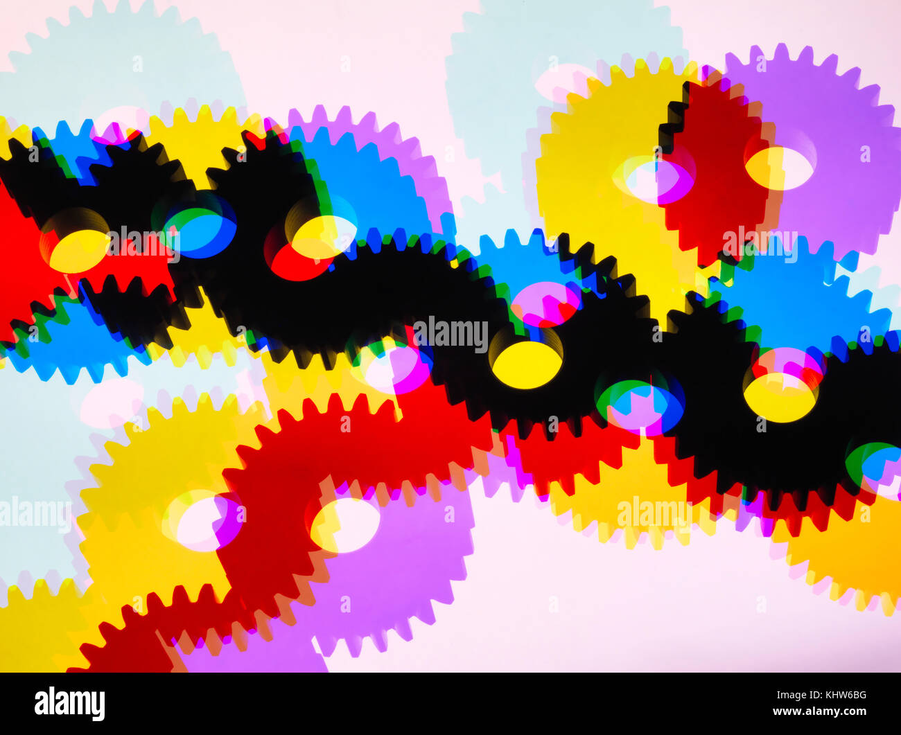 Engineering cog wheels connected to produce power and motion - Stock Image