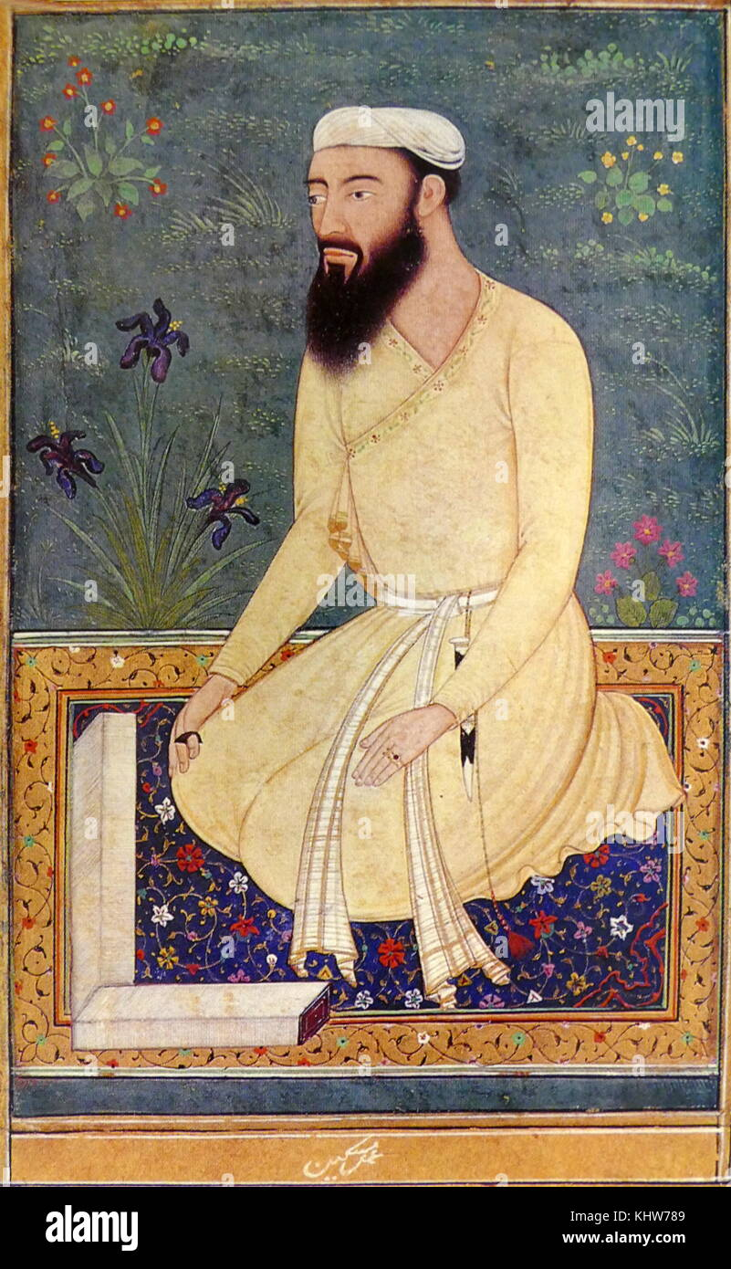 Portrait of a learned Mughal courtier. He is kneeling on a richly coloured carpet with the pages of unbound book - Stock Image