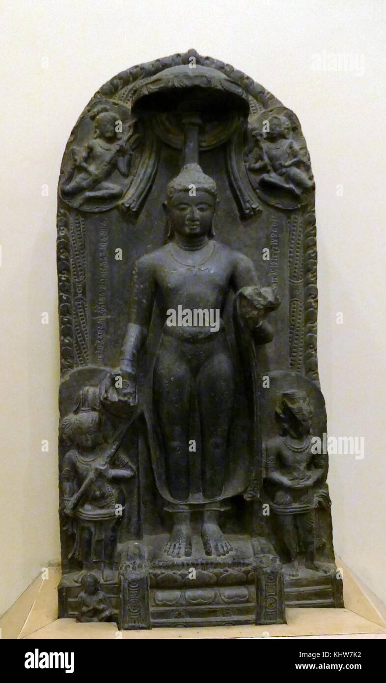 Stone statue depicting the descent of Buddha. Dated 11th Century - Stock Image