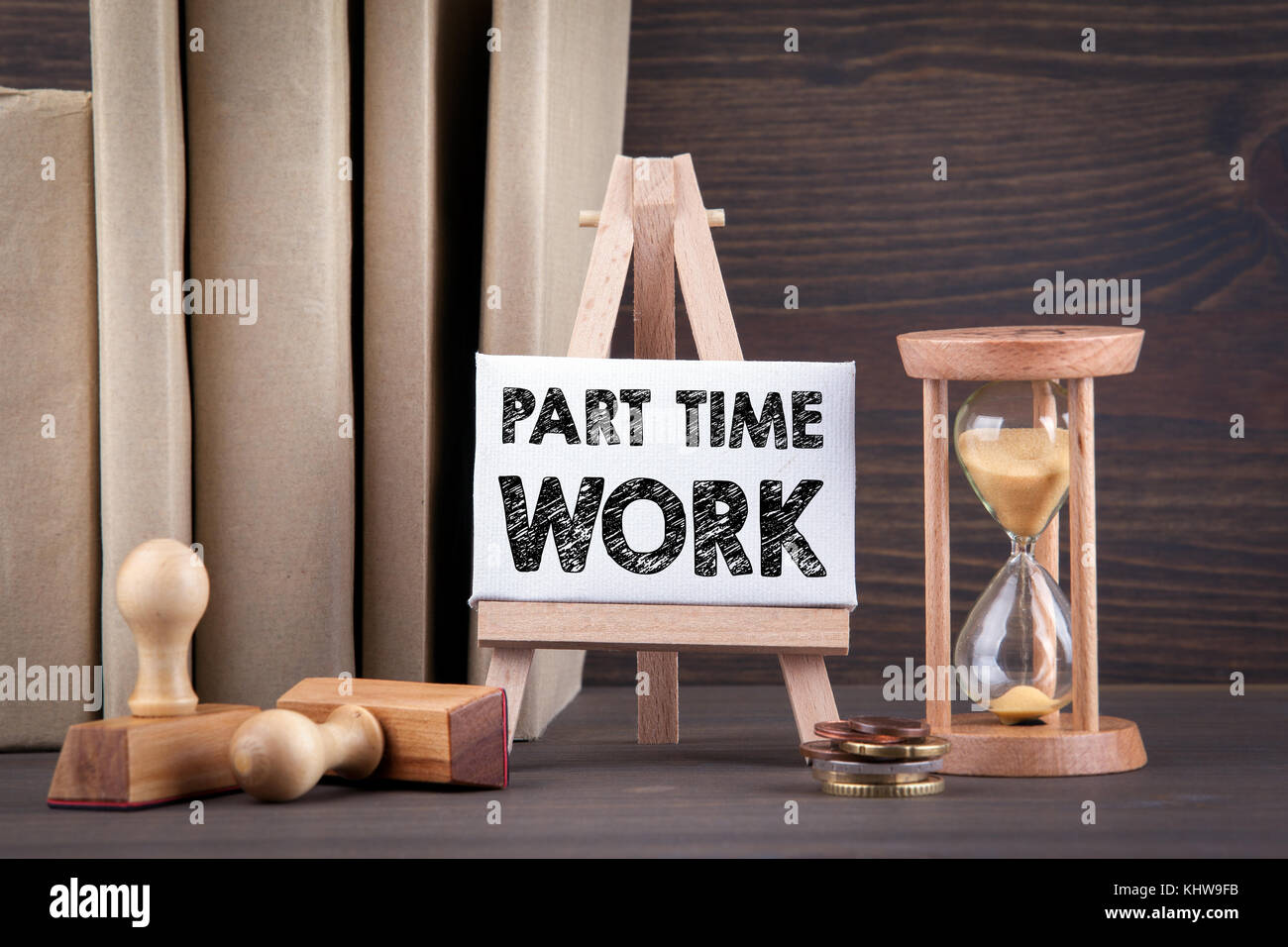 Part time work. Sandglass, hourglass or egg timer on wooden table  - Stock Image