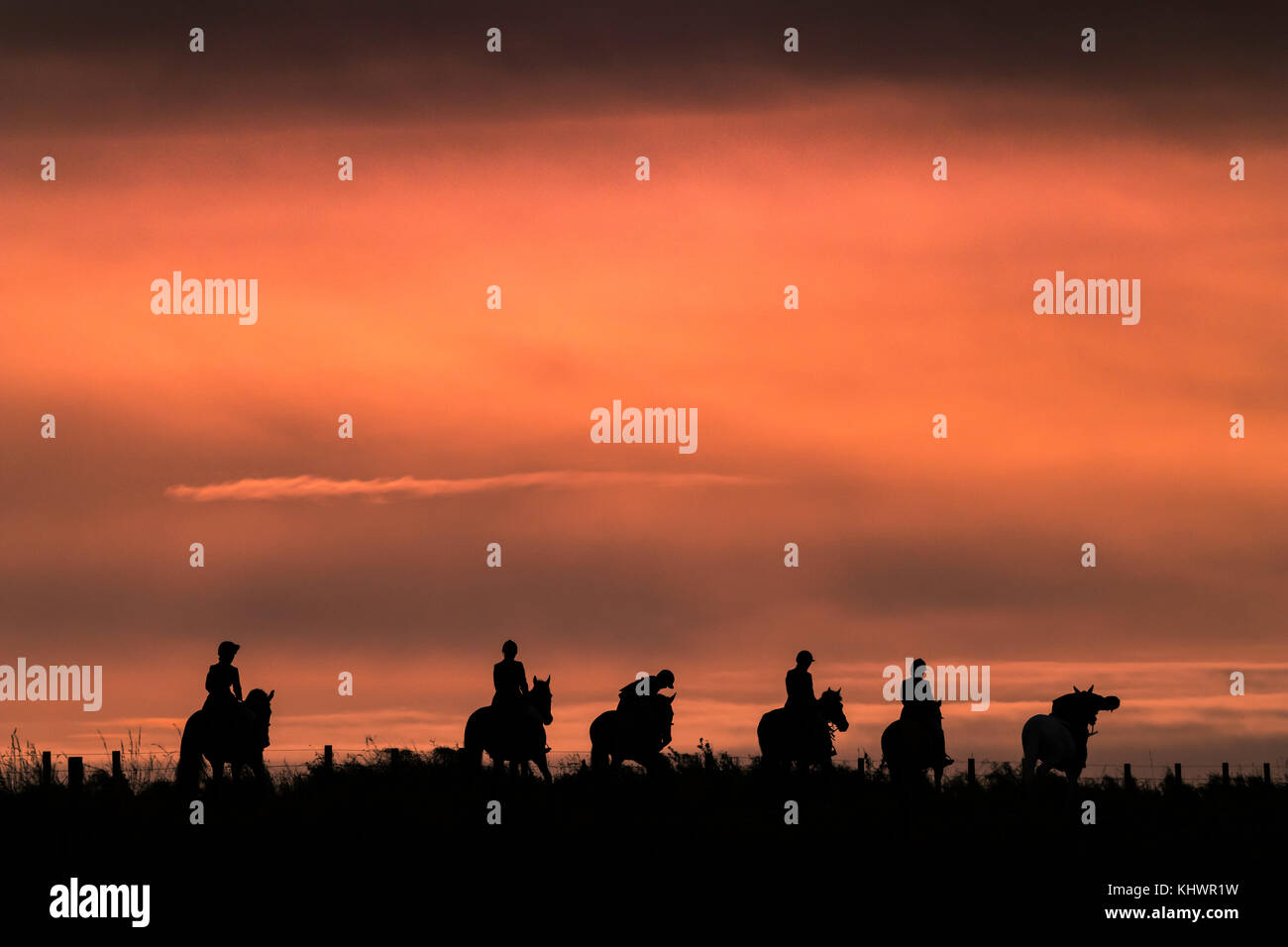 Mounted followers of the Duke of Buccleuch Hunt are silhouetted against a November afternoon sky in the Scottish Stock Photo