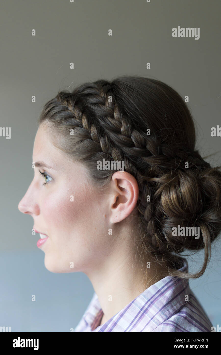 A young woman in her twenties with braided hair and wearing makeup in preparation for getting married Stock Photo